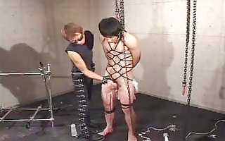bound oriental stud with gag in mouth in