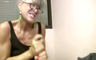 hot granny wearing spex tugs pecker for this