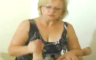 aged chick playing with cocks