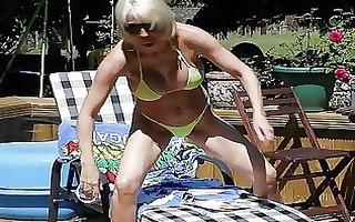 stylish blond momma in bikini shows her butt in