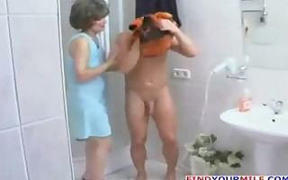 older bitch entice younger dude in the shower