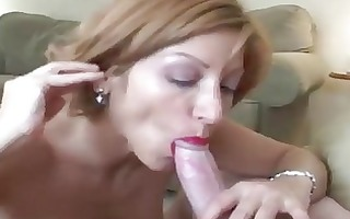 mature woman receives a face load of cum