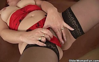 sexually excited granny in stockings is dildoing