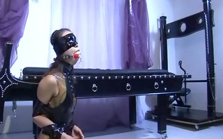 male in leather submits to taskmaster absurdum
