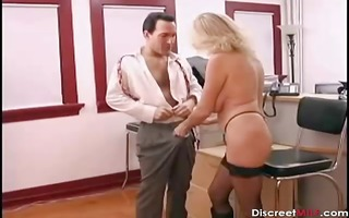 sexy older secretary seducing younger boss