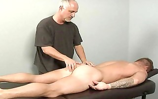 tattooed sexy gay dude acquires full body massage