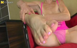 slender old granny sucks her own legs