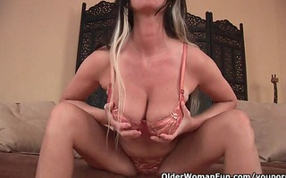 large boobed soccer mommy is toying her aged pussy