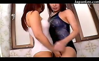 2 angels in swimming dresses cuttting holes to