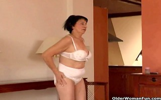 over 610 granny does striptease and masturbates