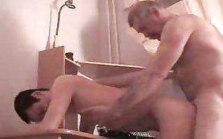 concupiscent homo daddy copulates his slender