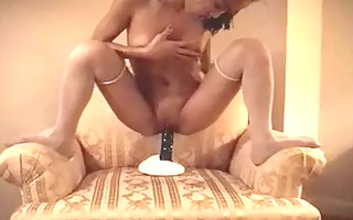 sexy oriental chick with fake penis