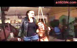 bondaged girl getting spanked whipped to red by