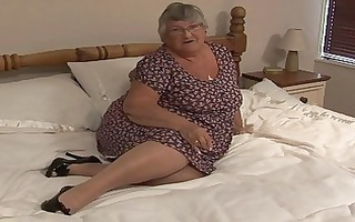 old dilettante granny masturbate on...