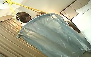 japanes babe fastened up in daybed for teasing