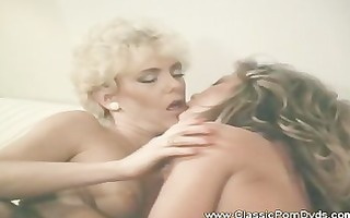 two excited babes in classic lesbo action with