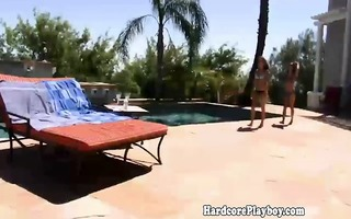 lesbo honeys in bikinis toying outdoors