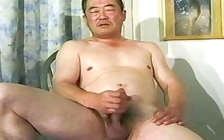 old oriental chap wanking his weenie untill