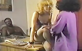 interracial three-some in retro movie scene