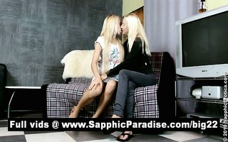 breathtaking blond lesbos giving a kiss and