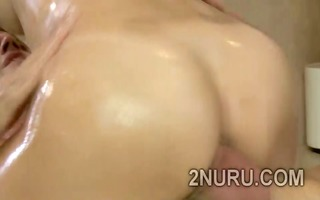busty dark brown honey massages clients with her