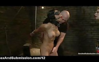 two tied chicks blindfolded and caned by