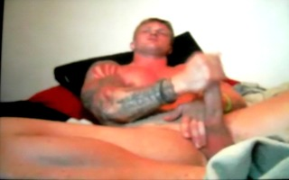 self engulf tatooed hung chap on web camera