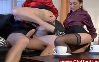 ladies in nylons sharing a bulky knob