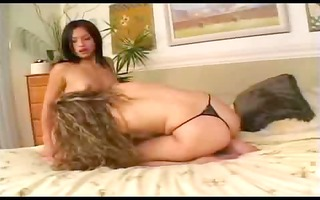 two agreeable lesbian babes on couch