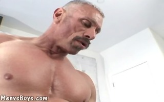 old muscleman lets a giant darksome shaft up his