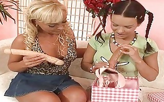 redhead with braids and blond mother i using toys