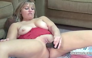 aged liisa copulates a large darksome vibrator