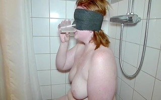 blindfold and a cup of cum