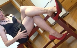older feet and red heels dangle