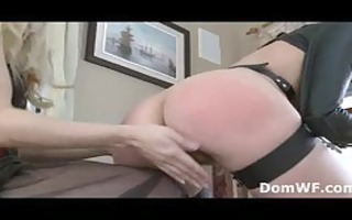 tied redhead in leather str jacket spanked by