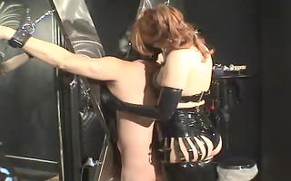 the dominatrix caresses her villein