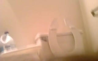 white top breeds black arse in restroom